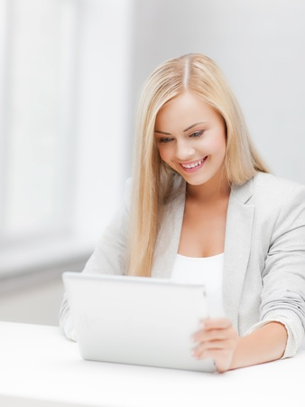 picture of smiling woman with tablet pc photo