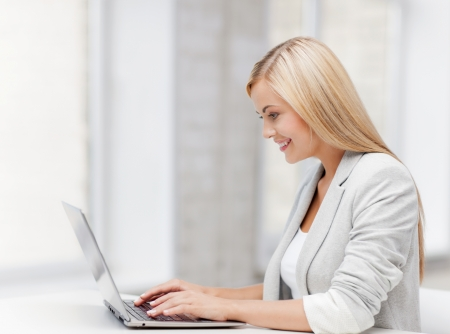 picture of smiling businesswoman using her laptop computer Stock Photo - 19504549