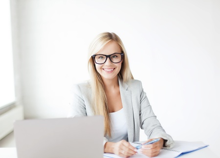 indoor picture of smiling woman with documents and pen photo