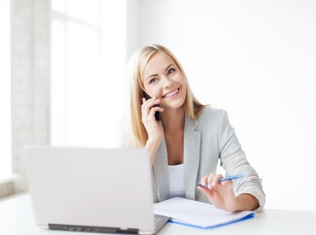 secretary woman: businesswoman talking on the phone and taking notes