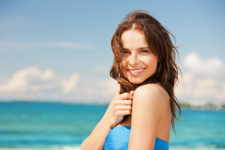 close up of beautiful woman in bikini smiling photo