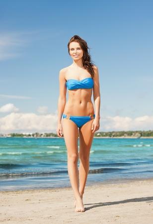 picture of beautiful woman in bikini smiling photo