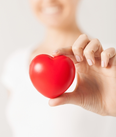 close up of woman hands with heart photo