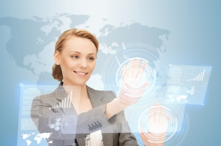 high tech world: picture of businesswoman working with virtual screens Stock Photo