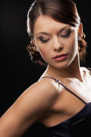 beautiful woman in evening dress wearing diamond earrings Stock Photo - 19563108