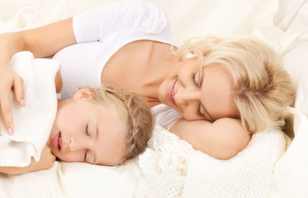 picture of happy mother and daughter sleeping photo