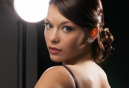 beautiful woman in evening dress wearing diamond earrings Stock Photo - 19563088