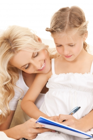 picture of mother and daughter doing home work Stock Photo - 19563054
