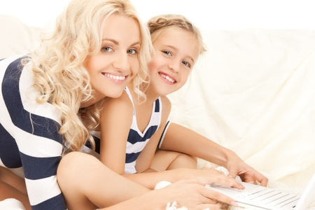picture of mother and daughter with laptop photo