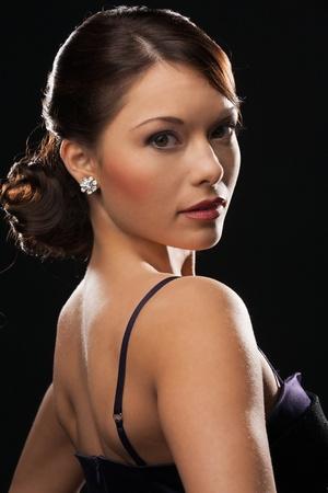 beautiful woman in evening dress wearing diamond earrings Stock Photo - 19563101
