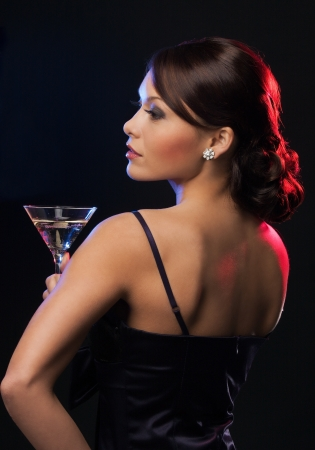 beautiful woman in evening dress with cocktail photo