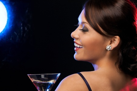 beautiful woman in evening dress with cocktail having fun photo