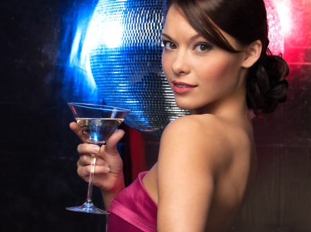 dancing disco: beautiful woman in evening dress with cocktail  and disco ball