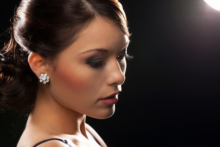 beautiful woman in evening dress wearing diamond earrings Stock Photo - 19563099
