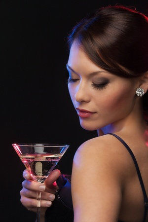 diamond jewellery: beautiful woman in evening dress with cocktail