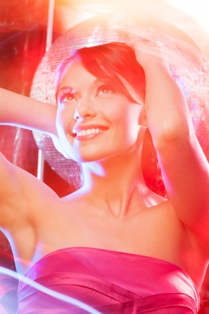 beautiful woman in evening dress with disco ball Stock Photo - 19563087