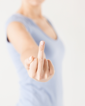 insulting: close up of woman showing middle finger