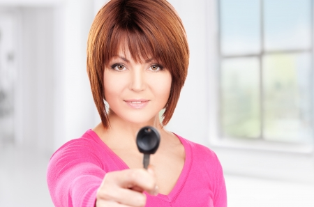 middle age women: picture of happy woman with car key