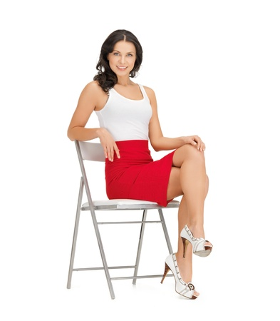 happy woman in casual clothes sitting on chair photo