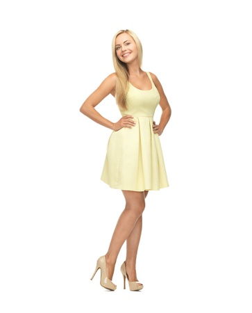 picture of young woman in yellow dress on high heels photo