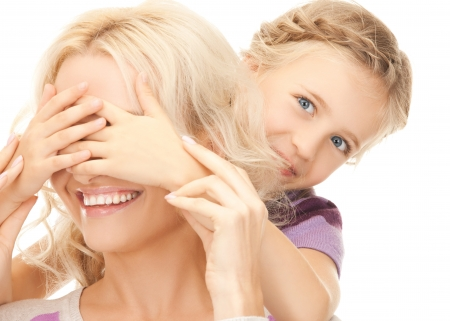 seek: picture of mother and daughter making a joke or playing hide and seek