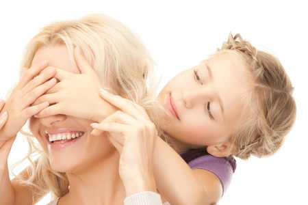 picture of mother and daughter making a joke or playing hide and seek Stock Photo - 19563037