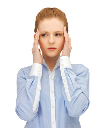 stressed woman holding her head with hands. photo