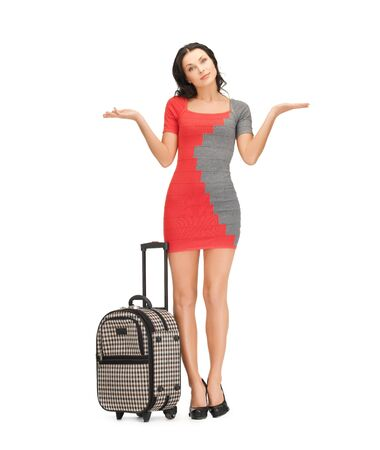 unknowing: picture of doubting woman in dress with suitcase Stock Photo