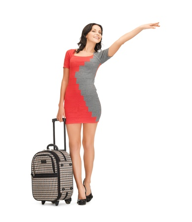 hurry up: picture of smiling woman in dress with suitcase hitchhiking