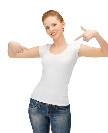 barefoot teens: happy woman in blank white t-shirt pointing at herself Stock Photo