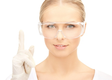 lab tech: picture of female scientist in eyeglasses holding finger up Stock Photo