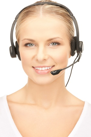 close up of friendly female helpline operator with headphones photo