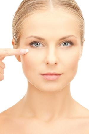 eyelid: face of beautiful woman touching her eye area Stock Photo