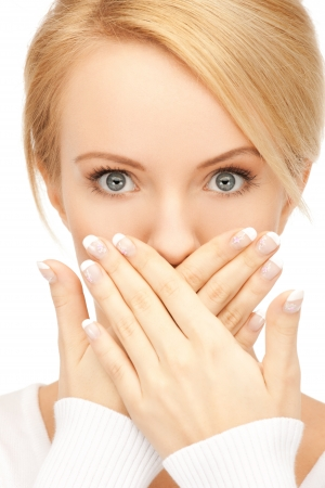 hands in mouth: picture of amazed woman with hand over mouth