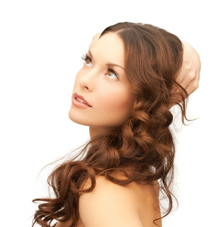 seductive women: picture of beautiful woman playing with long hair Stock Photo