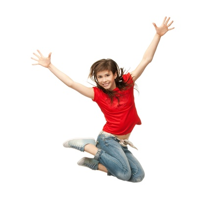 picture of happy girl jumping in the air photo