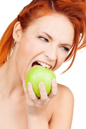 picture of healthy woman biting green apple photo