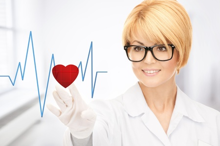 picture of attractive doctor pressing virtual button with heart diagram