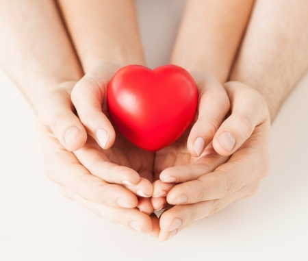 close up of woman and man hands with heart photo