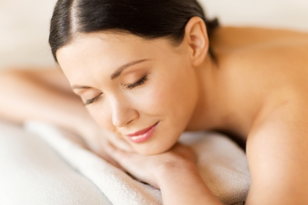 therapeutic: picture of woman in spa salon lying on the massage desk