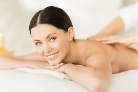 woman massage: picture of woman in spa salon getting massage Stock Photo