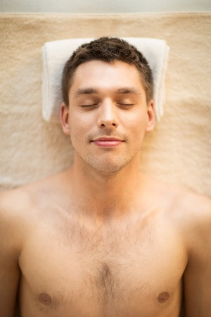 close up of man face in spa salon photo
