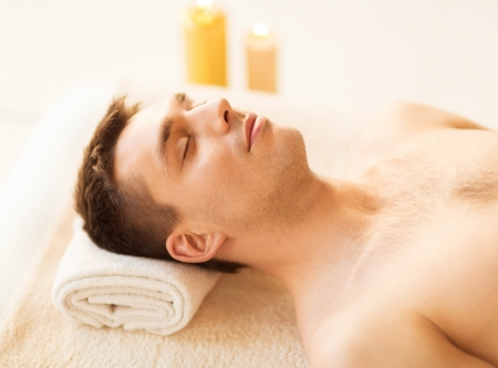 male facial: close up of man face in spa salon