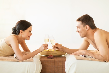 newlywed couple: picture of couple in spa salon drinking champagne