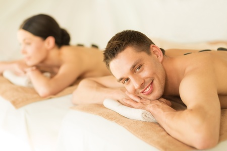 picture of couple in spa salon with hot stones photo