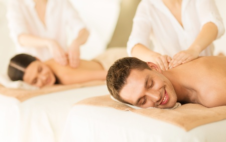 picture of couple in spa salon getting massage photo