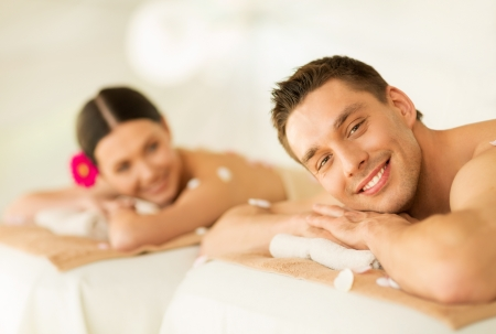 picture of couple in spa salon lying on the massage desks Stock Photo - 19703130