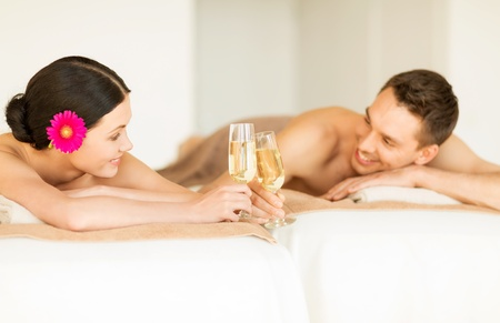 couples therapy: picture of couple in spa salon drinking champagne