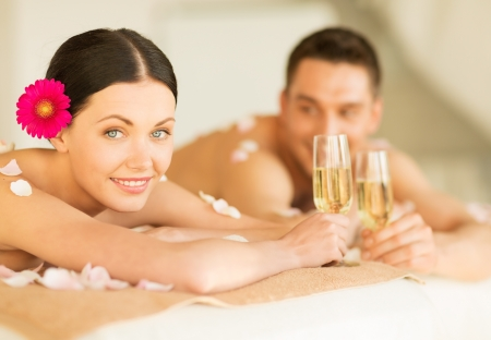 all smiles: picture of couple in spa salon drinking champagne
