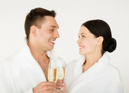picture of couple in spa salon in white bathrobes with champagne photo